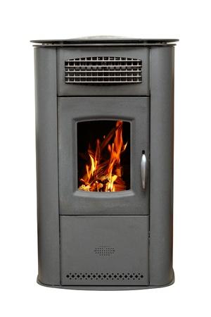 鉄の白い背景で隔離の木製火の燃焼とストーブ 写真素材