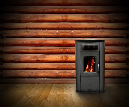 interior of wooden cabin with vintage stove and burning fire- empty backdrop for your design photo
