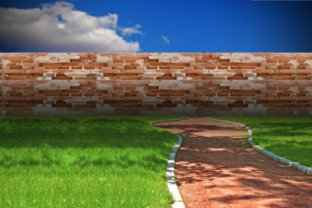 concept with cinder foot path blocked by brick wall