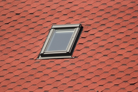 roofing system: detail of roof window on top of the house