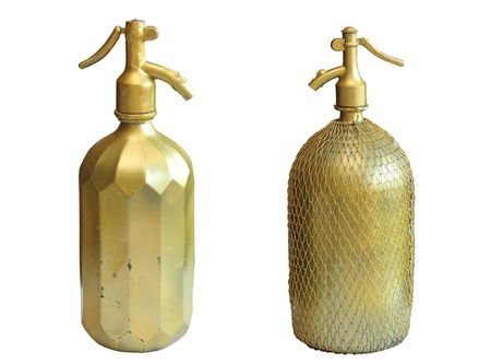 ancient copper bottles for sparkling water isolated over white background photo