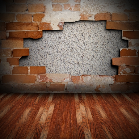 architectural vintage background with cracked brick wall and brown wood floor photo