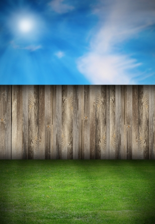beautiful natural backdrop with wooden fence and green turf photo