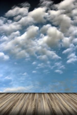 abstract view to the cloudy sky from old wooden floor  photo