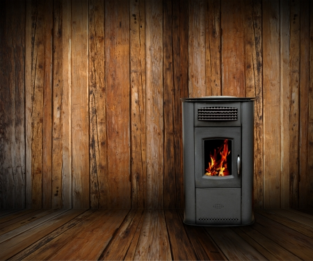 cozy interior backdrop of a wooden lodge with burning stove Stock Photo