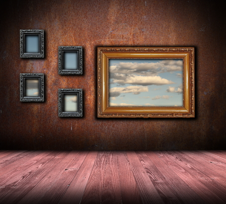 beautiful interior backdrop with antique painting frames on rusty wall photo