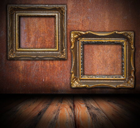 empty painting frames on rusted wall, interior architectural backdrop for your design photo