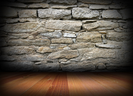 weathered stone wall and wood floor on interior architectural backdrop photo