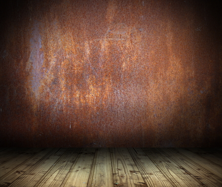 industrial interior background with rusty metal wall and wood floor photo
