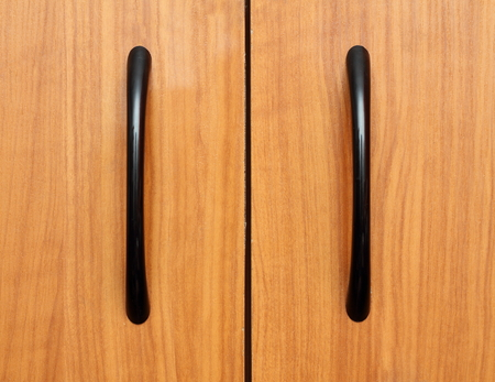 close up of handle on wooden  furniture photo