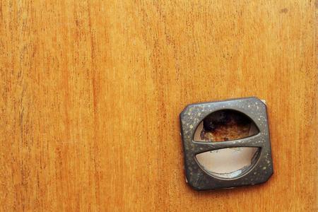 detail of old damaged  furniture handle photo