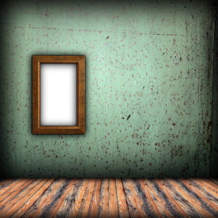 empty frame on indoor background with green grungy wall and wood floor photo