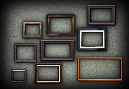 green grungy wall full of wooden picture frames for your design photo