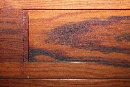 detail of beautiful textured red pine plank on old furniture photo