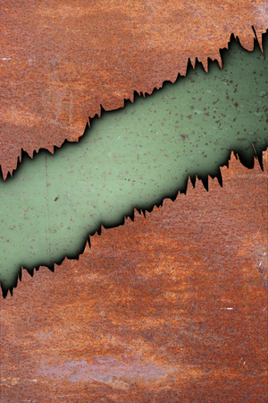 metal rust texture with cracks over old green painted surface photo