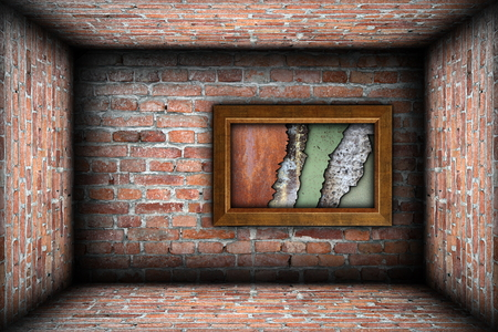 painting frame with weathered textures on grungy brick wall photo