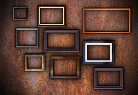 rusty wall full of empty frames ready for your design or message photo