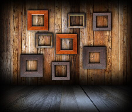 wooden interior background with empty  frames on wall for your message or advertising photo