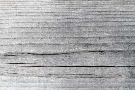 detail of weathered fir plank exposed to weather for long time, old wooden texture photo