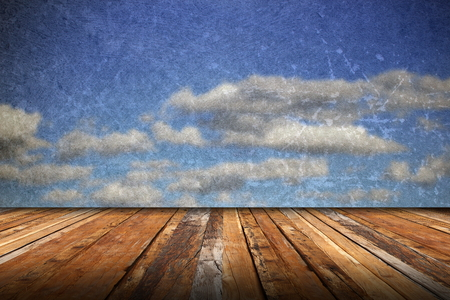 abstract scratched backdrop with wood terrace and grungy beautiful blue sky photo