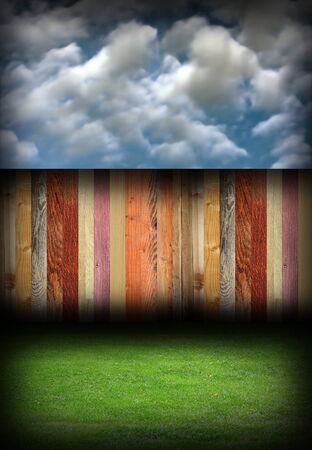 abstract colorful wood fence in backyard, natural backdrop with blue cloudy sky photo