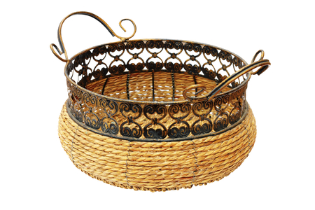 wicker basket for bread or fruits, isolated over white  photo