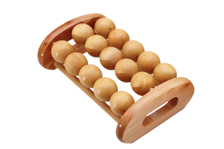 wooden massager for feet isolated over white background photo
