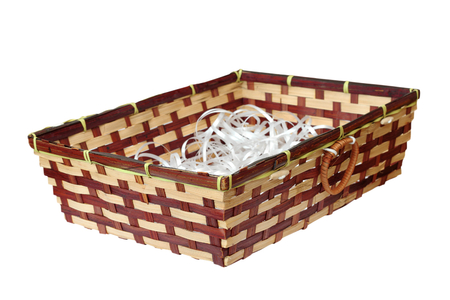isolated wattle basket full of white plastic ribands photo