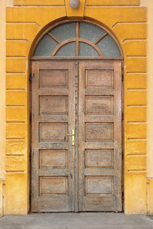 old wooden traditional door on building facade