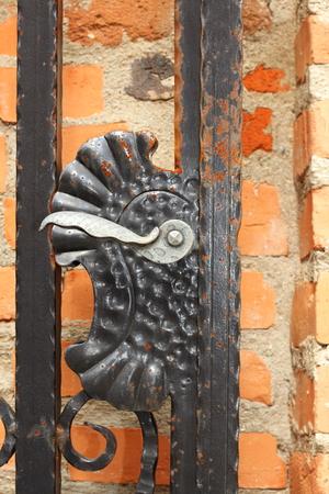wicket gate: old metal door finger on ancient gateway, detail