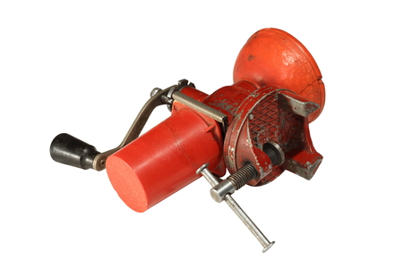 mincing: old red mincing machine isolated over white background, weathered used kitchen utensil