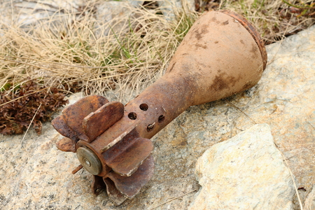 artillery shell: rusty bomb shell case from second world war found in the mountains near the trenches Stock Photo