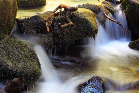 amongst: detail on a mountain stream, beautiful waterfall amongst the rocks
