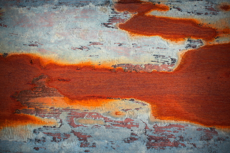 orange rust on old metal surface, colorful texture for your design