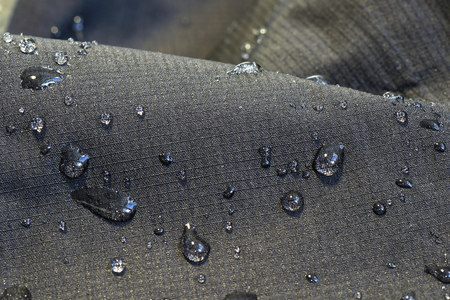 water repellent: detail of fabric water repellent, close up on an outdoor jacket material with water drops Stock Photo