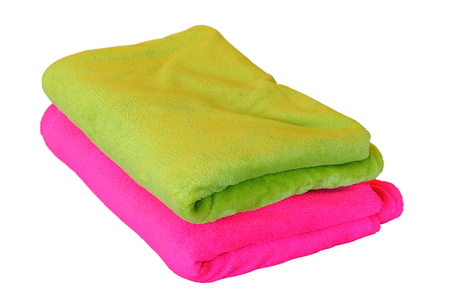 bedspread: two blankets isolated over white background, green and pink