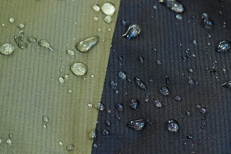 impermeable: water repellent material of a jacket, waterdrops on surface