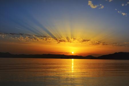colorful sunsetover the sea in Milos island, Greece 版權商用圖片