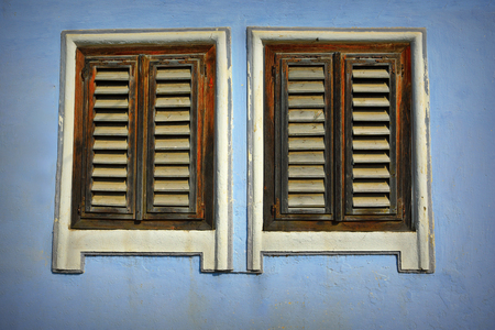 traditional wooden shutters of an old house from Transylvania 스톡 콘텐츠