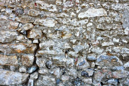 cracked surface of old stone wall, texture for your design 스톡 콘텐츠