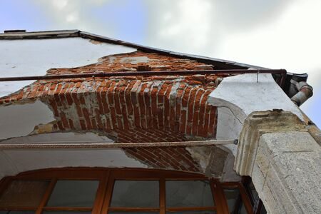 dampness effect on old house, plaster layer destroyed by  rain water leakage 写真素材