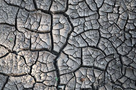 natural cracked mud texture after a long period of  drought 스톡 콘텐츠