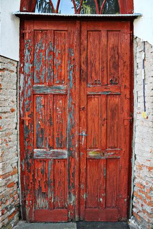 old damaged wooden door, architectural background for your design