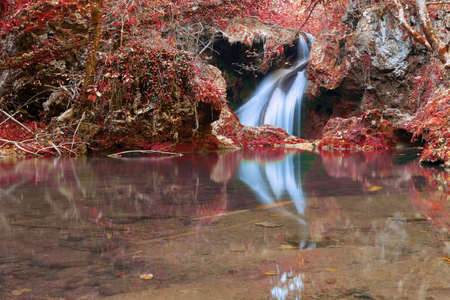 Vaioaga waterfall in autumn colors, Beusnita National Park, Romania