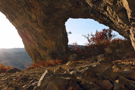 beautiful natural arch in Apuseni mountains, Romania; students cave is a rock formation near Remetea, in Trascau Standard-Bild