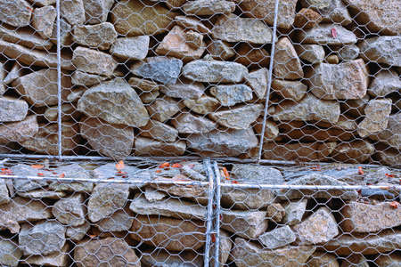support stone wall in metallic net,  texture for your design Standard-Bild