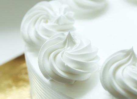 cake decorating: Close up of whipping cream cake. Stock Photo