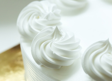 Close up of whipping cream cake. Foto de archivo