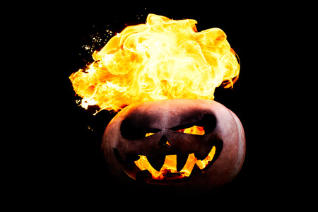 spewing: Halloween pumpkin is spewing fire flame flow on a black background is very impressive and colorful