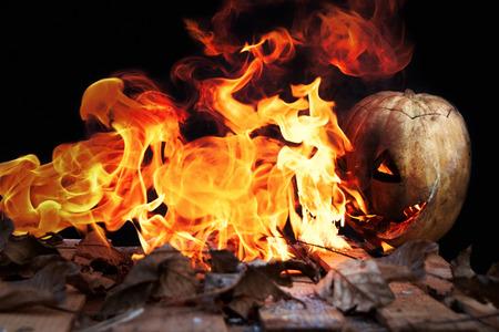 spewing: Halloween pumpkin spewing flames of fire on a black background